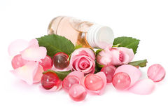 Bath oil, pearls and flowers Stock Photography