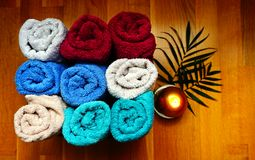Free Bath Or Wellness Accessories, Soft Terry Colorful Towels Stacked In A Box On The Wooden Background Stock Image - 165584501