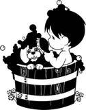Bath parlant de Little Boy avec le chiot Photo stock