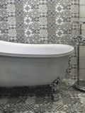 Bath in patterned bathroom royalty free stock photo