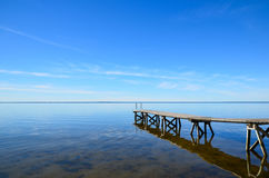 Bath pier at calm water Stock Images