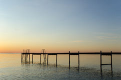 Bath pier silhouette. By sunset at the coast of the swedish island Oland in the Baltic Sea Stock Photo