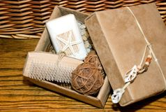 Bath Products. Still life of various bath products on old oak and woven basket background Royalty Free Stock Photos