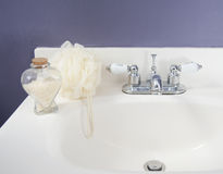 Bath products in bathroom Stock Images
