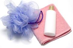 Bath puff liquid soap and towel Royalty Free Stock Image