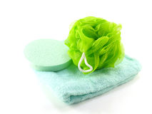 Bath puff and sponge with towel on white background Royalty Free Stock Photo