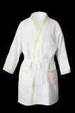 Bath robe. White fresh bath robe isolated on black background Royalty Free Stock Photography