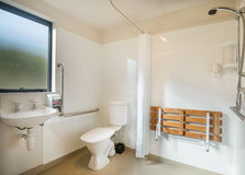 Bath room design for disable. White bath room design for disable Royalty Free Stock Photos