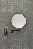 Bath room mirror. Folding bath room mirror against a wall with gray ceramic tiles Stock Photography
