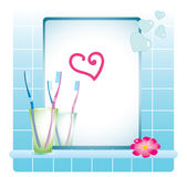 Bath-room mirror, tooth-brushes. And flower and heart Royalty Free Stock Photo