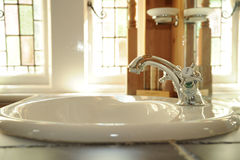 Bath room Sink. Photograph of a bathroom sink shot using natural light Royalty Free Stock Photography