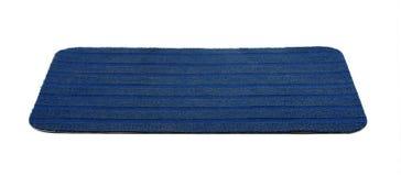Bath rug. Blue bath rug isolated on white Stock Photo