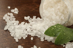 Bath salt. Close-up of bath salt spilled on a wooden surface Stock Image