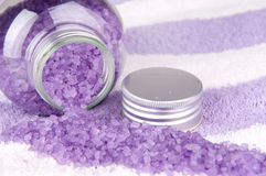 Bath salt. Violet bath salt on towel background Stock Photos