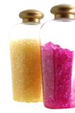Bath salt. Pink and yellow bath salt in flask Royalty Free Stock Photos