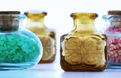 Bath salt. In colored glass bottle royalty free stock images