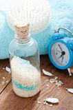 Bath salt and alarm clock Stock Images