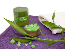 Bath salt, aroma candle and bamboo leafs Stock Image
