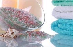 Bath salt and bathing towels Stock Photo