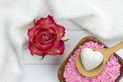 Bath salt in bowl and heart shaped bath fizzer Royalty Free Stock Images