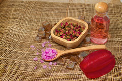Bath salt and essential rose oils Stock Photo