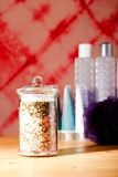 Bath salt in glass jar in front of other accessories Royalty Free Stock Photo