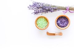 Bath salt in herbal cosmetic with lavender on white desk background top view space for text Stock Image