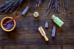 Bath salt in herbal cosmetic with lavender on wooden desk background top view space for text Royalty Free Stock Photos