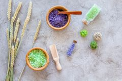 Bath salt in herbal cosmetic with wheat on stone desk background top view Royalty Free Stock Photo