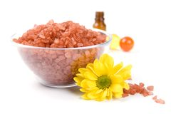 Bath salt, oil balls in a bowl and flower Stock Photos