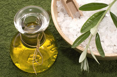 Bath salt, oil and olive branch Royalty Free Stock Images