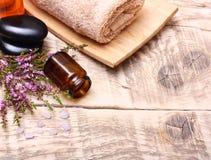 Bath salt, oil, towel and stones Stock Photo