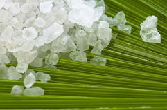 Bath salt and palm leaf Stock Photo