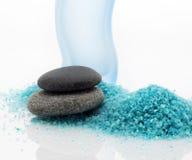 Bath salt and pebble stones. Mineral bath salt with pebble stones and blue pot Stock Photo