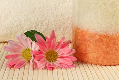 Bath salt with pink flowers Royalty Free Stock Image
