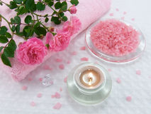 Bath salt with rose oil, candle and roses Stock Photography