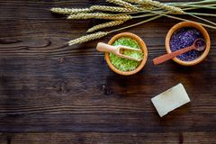 Bath salt and soap in herbal cosmetic with wheat on wooden desk background top view space for text Royalty Free Stock Images