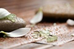 Bath salt on spa stones stock photos
