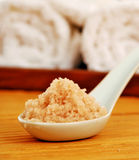 Bath salt on a spoon with bath accessories Stock Photo