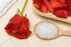 Bath salt in a spoon and rose Stock Images