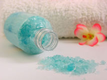 Bath salt and towel. Bath salt with a small flower and towel in background in blur Stock Images