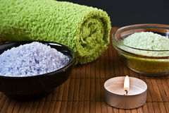 Bath salt with towel and burning candle Royalty Free Stock Image