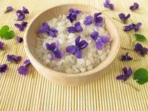 Bath salt with violet flowers Stock Image