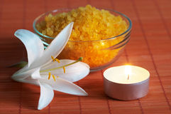 Bath salt and white lily on bamboo mat Royalty Free Stock Photos