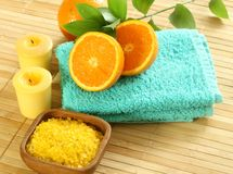 Bath salt in wooden bowl, towel, candle and fresh Royalty Free Stock Photos