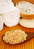 Bath salt on a wooden spoon with bath accessories Stock Photography