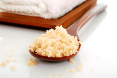 Bath salt on a wooden spoon closeup Royalty Free Stock Photography