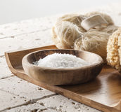 Bath salt on wooden tray for spa treatment. Bath salt and soap for pure hydration Stock Photo