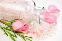 Bath salts. Pink bath salts in a glass jar with flowers and herbs Stock Photo