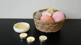 Bath salts, bright bath bombs are in the basket and burning candles are on the table. Romantic atmosphere.  stock video footage